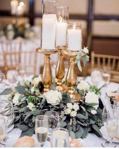 Wedding Centerpiece Ideas Gold Candle Stands With Greenery And White Roses