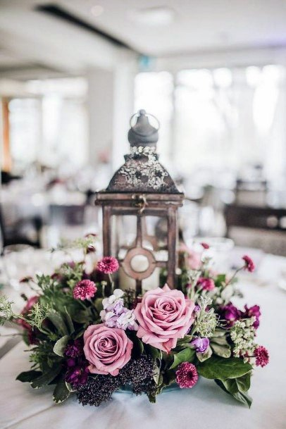 Whimsical Lantern With Greenery And Pink Roses Wedding Centerpiece Ideas