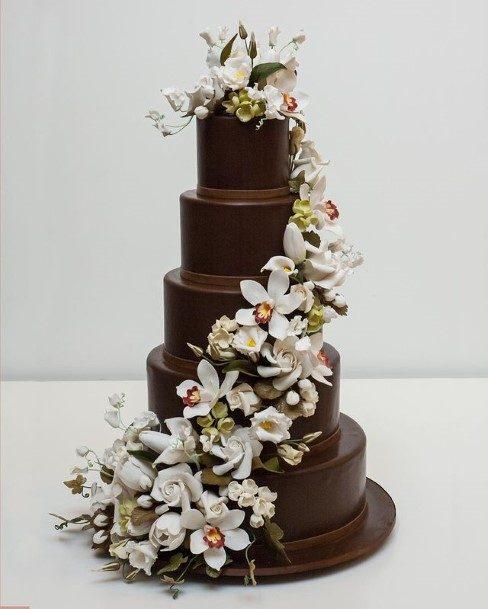 White Blossoms Garland On Chocolate Wedding Cake
