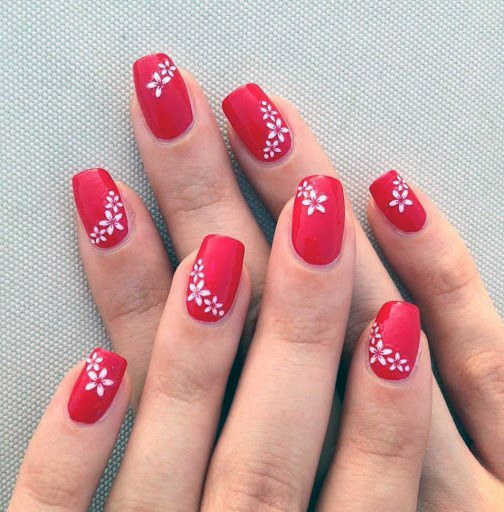 White Floral Art On Bright Red Nails For Women
