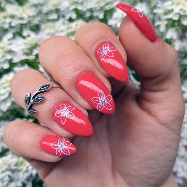 White Floral Design On Bright Red Nails For Women