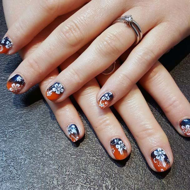 White Flower Art On Blue Orange Nails For Women