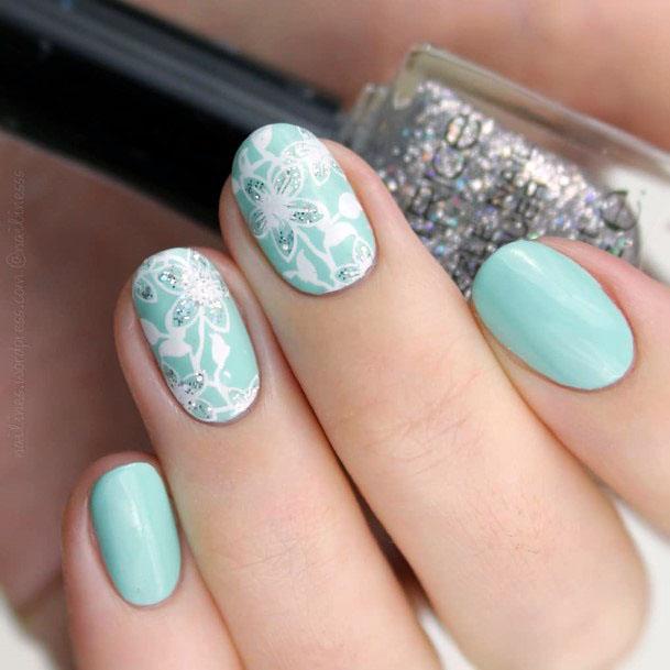 White Flower Art On Mint Toned Nails Women