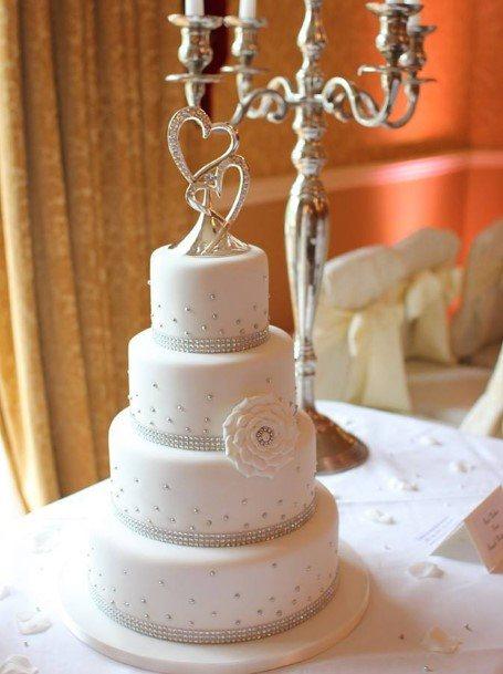 White Four Tier Wedding Cake With Diamnate Details