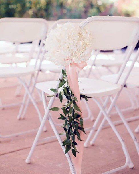 White Hydrangea Flowers On Chair