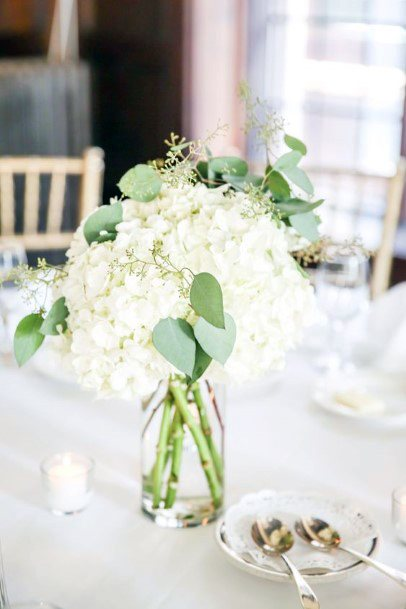 White Hydrangea Wedding Flowers On Dining Table