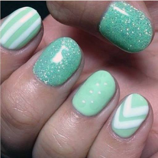 White Lines And Chevron Design On Mint Nails Women