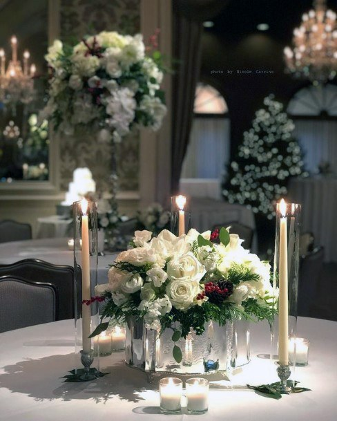 White Roses And Candles Christmas Wedding Flowers
