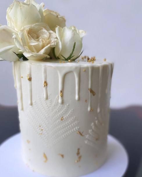 White Roses On Melting Icing Wedding White Cake
