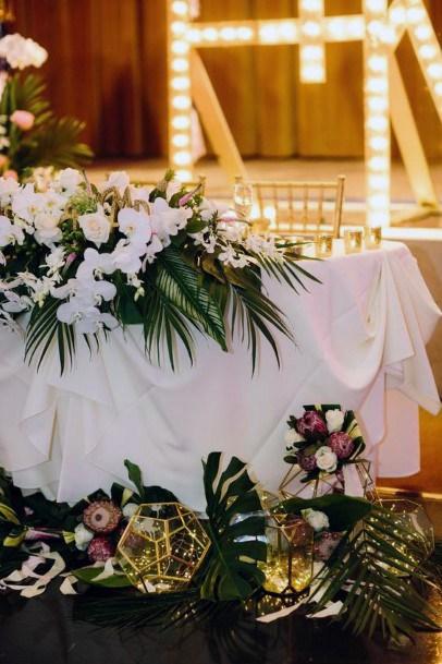 White Table Cloth And Hawaiian Wedding Flowers