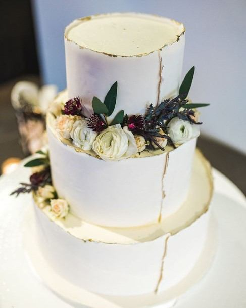 White Wedding Cake With Crack Designs Art