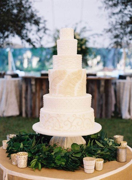 White Wedding Cake With Golden Accent Art