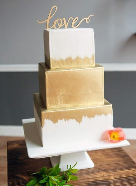 White Wedding Cake With Golden Spray Paint