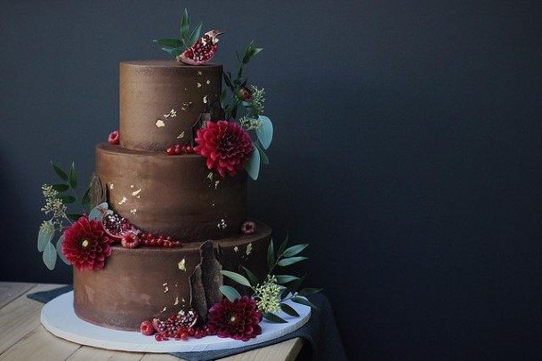 Wine Red Blossoms On Chocolate Wedding Cake