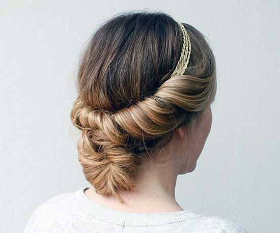 Woman With Medium Blonde Hair Twisted Into Low Bun