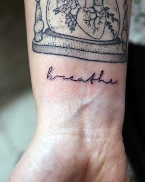 Womens Breathe Tattoo On Wrist