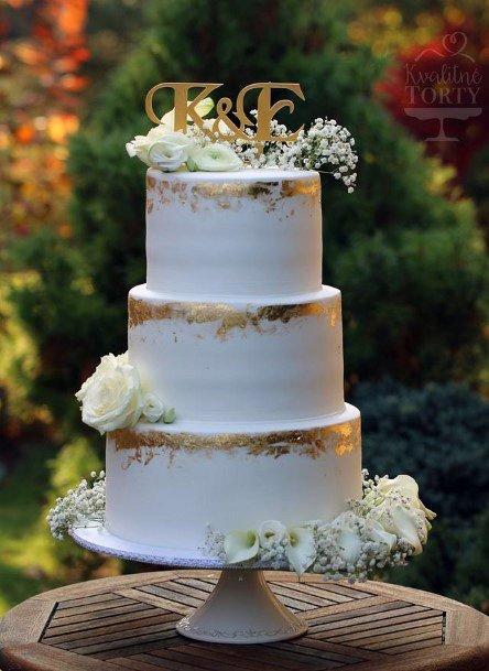 Womens Golden Art Work On Elegant Wedding Cake