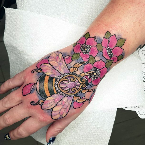 Womens Hands Colorful Flowers And Bees Tattoo