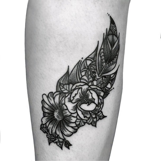 Womens Legs Black Flowers And Feather Tattoo