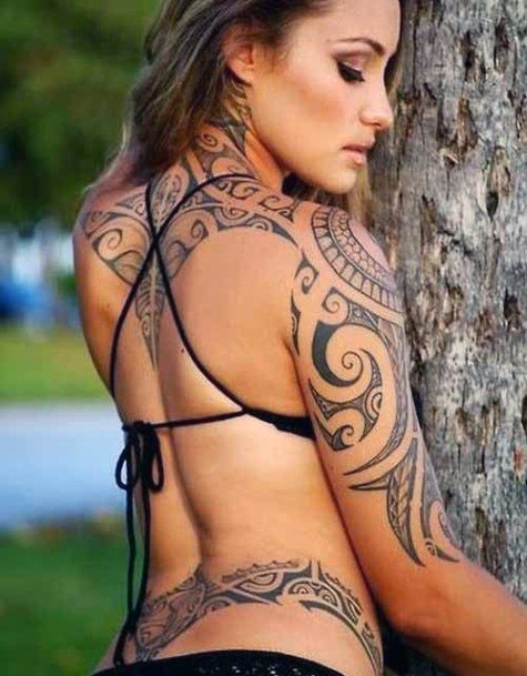 Womens Primitive Tribal Tattoo On Arms And Back