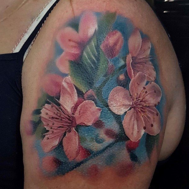 Womens Upper Arms Sky Blue And Cherry Blossom Tattoo Design