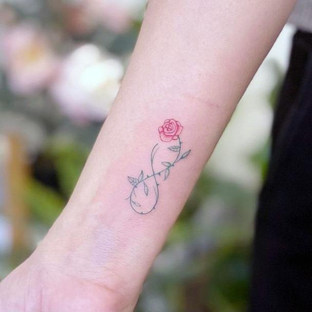 Womens Wrists Pink Rose And Leafy Stalk Infinity Tattoo