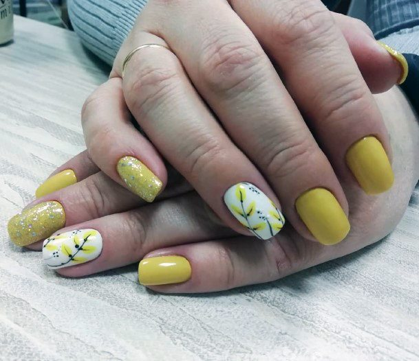 Yellow Japanese Blossoms On White Nails